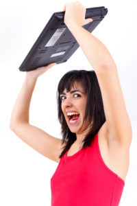 Agitated woman with laptop